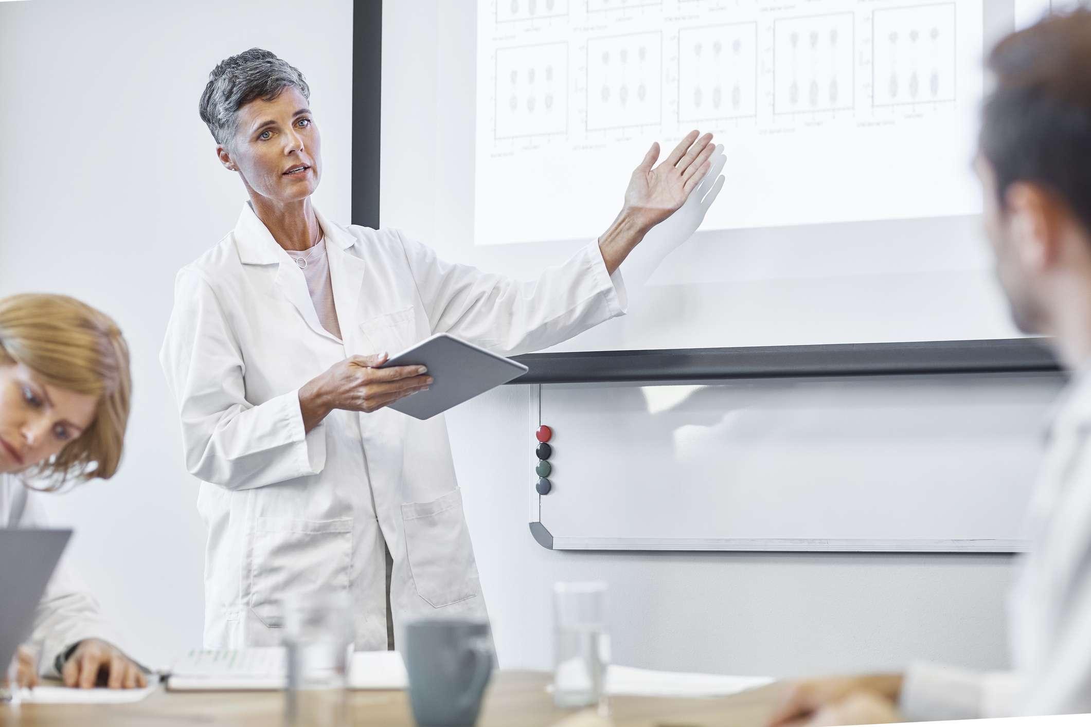 Female scientist discussing cancer treatment