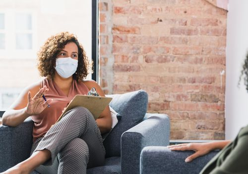 Therapist wearing a face mask.