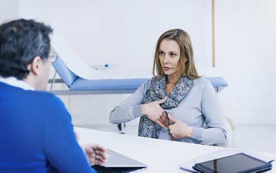 A patient consulting her doctor for stomach pain