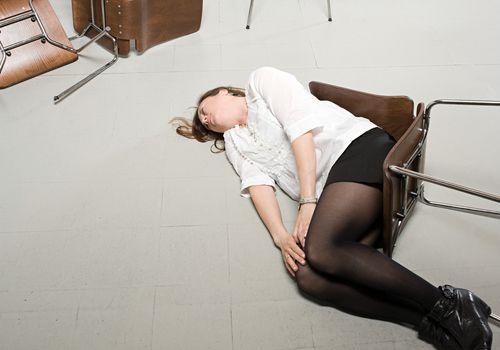 Woman having a seizure on the floor