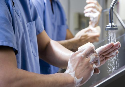 Surgeons washing hands before surgery