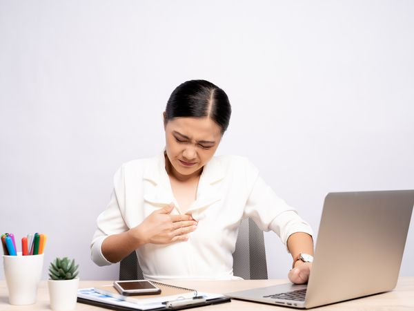 Experiencing acid reflux while working on computer
