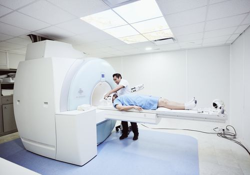 Person undergoing an MRI.
