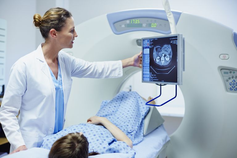 Doctor showing CT scan to patient