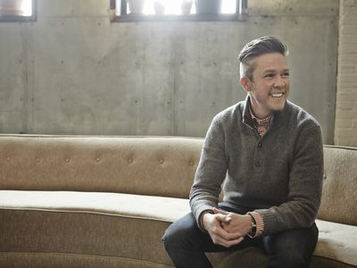 Stylish transgender man in modern living room