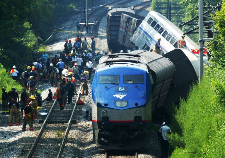 WASHINGTON - JULY 29: Rescue workers stand next to a derailed Amtrak passenger train which was on route from Chicago to Washington.
