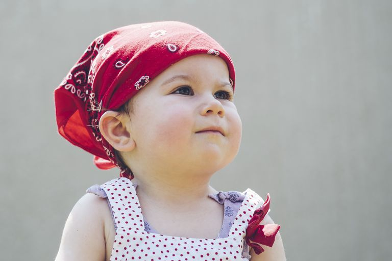 toddler wearing a bandana