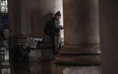 homeless man at night