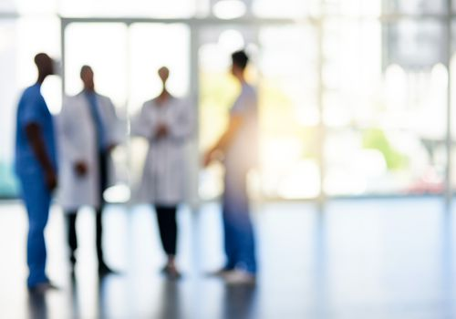 Group of doctors in a hallway, out of focus