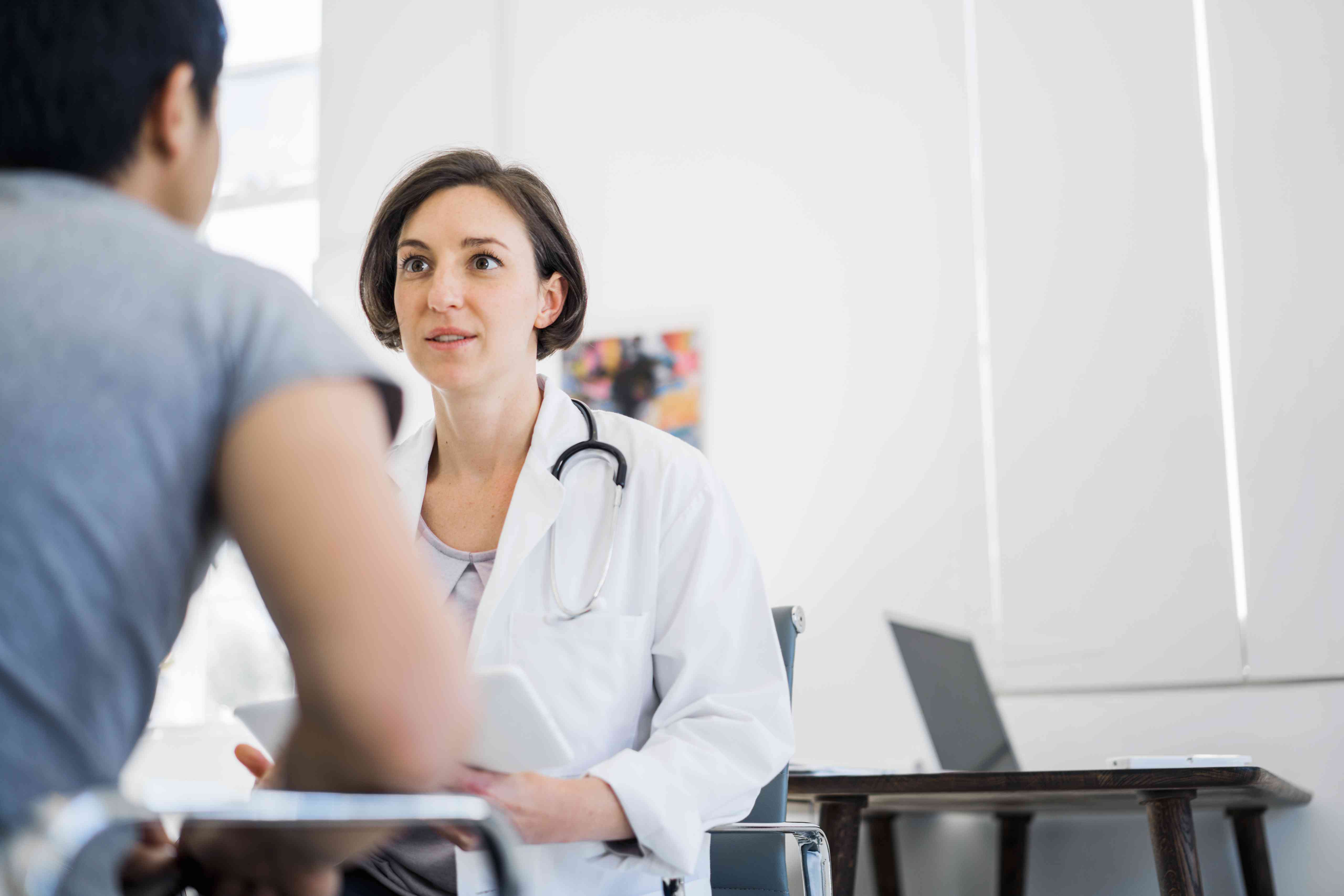 Female doctor going over test results with patient