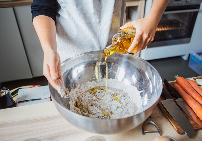 Woman making dough with vegetable oil