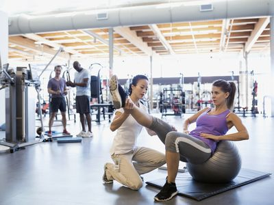 Physical therapist working with client at gym