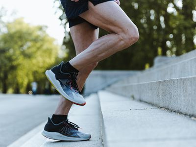 Close Up Of Legs Of A Sporty Man Training Up On The Stairs