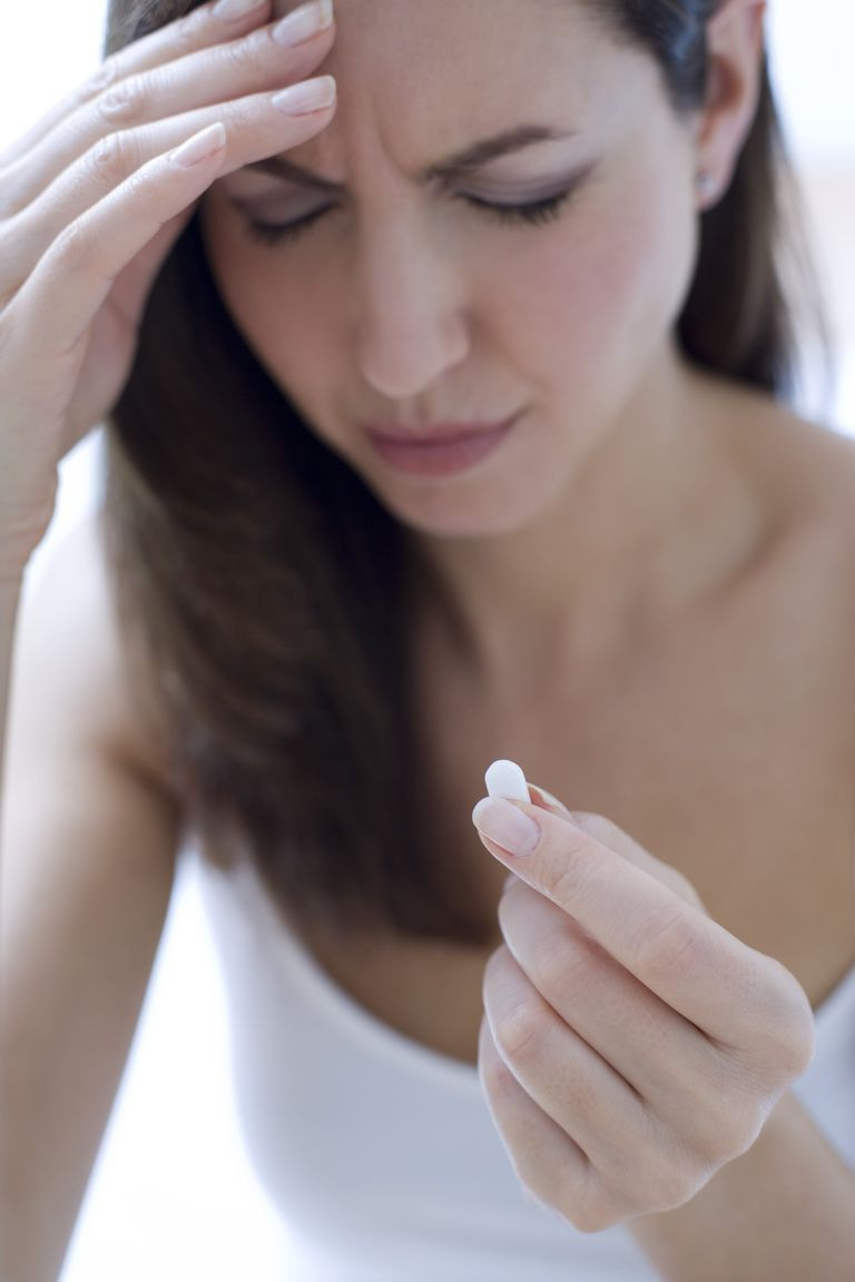 woman taking Tylenol for headache