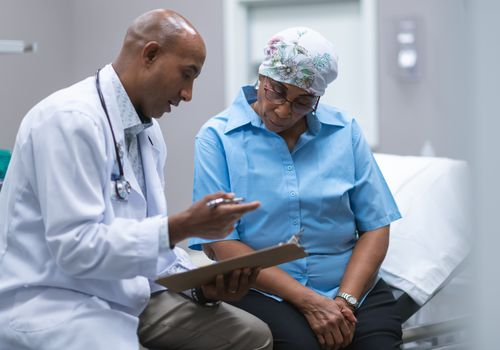 Woman with cancer consulting with doctor.