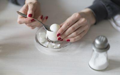 woman cracking an egg