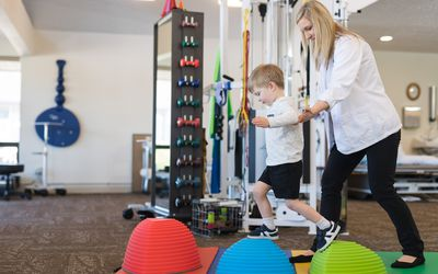 Pediatric physical therapist working with a child.