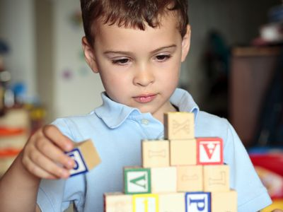 autistic boy playing with blocks