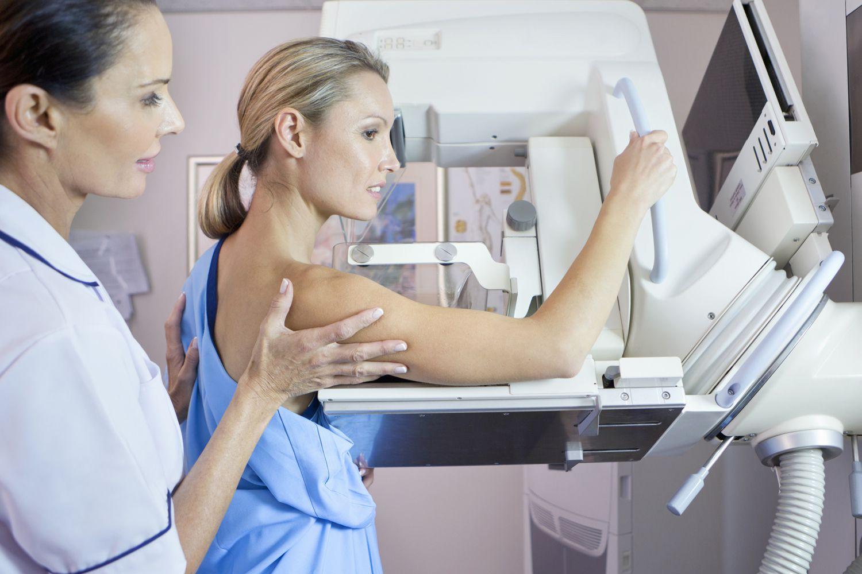 A woman undergoing a mammogram.