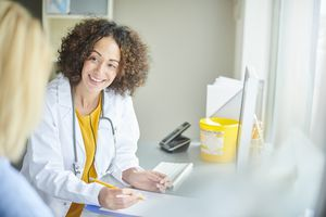 Young woman talking to her doctor