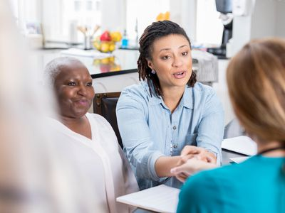 Senior woman's daughter visits with her mother's nurse