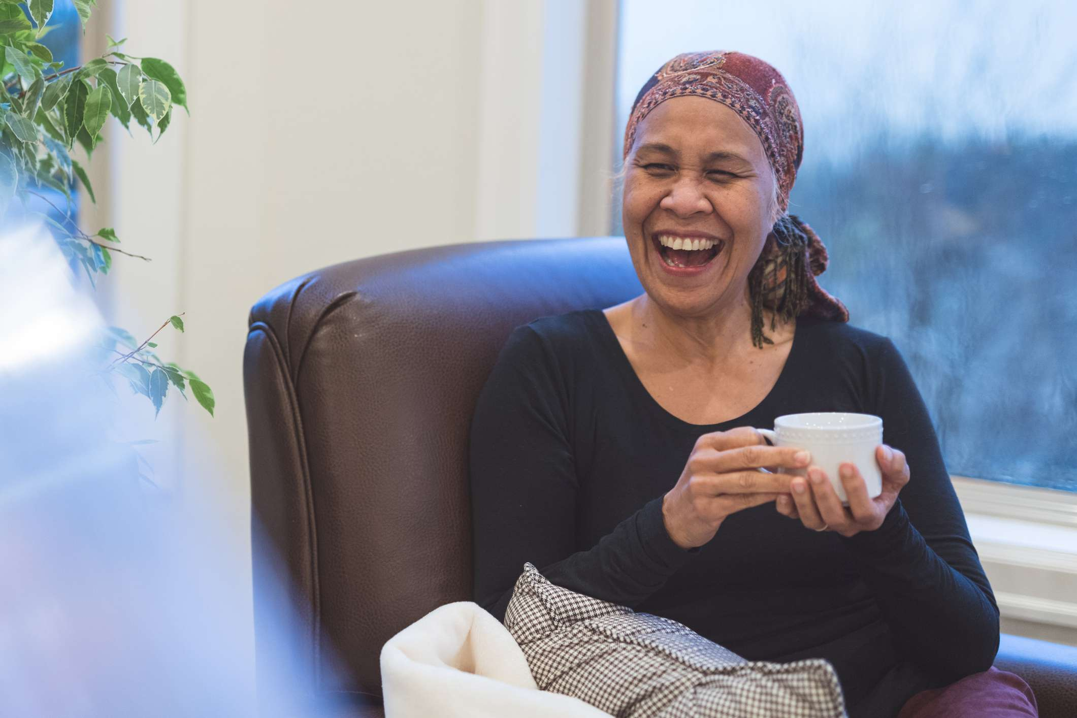 A women laughing although she has cancer