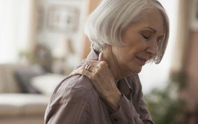 An elderly woman suffering from shoulder pain.