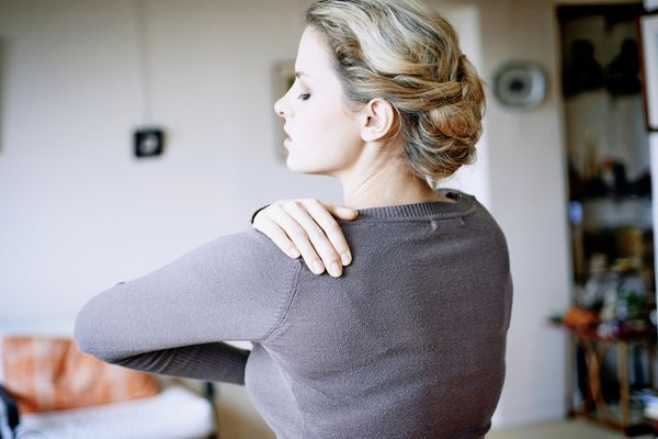 Woman suffering from shoulder pain, France