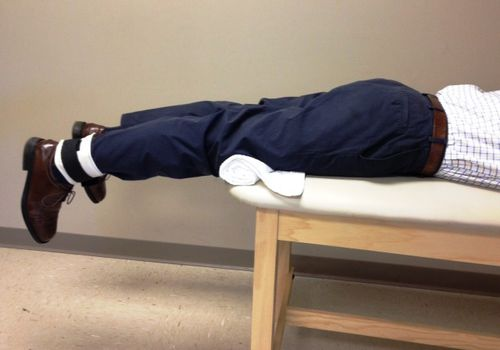 man demonstrating the prone hang exercise