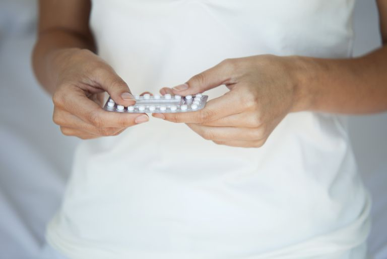 woman with birth control pill pack