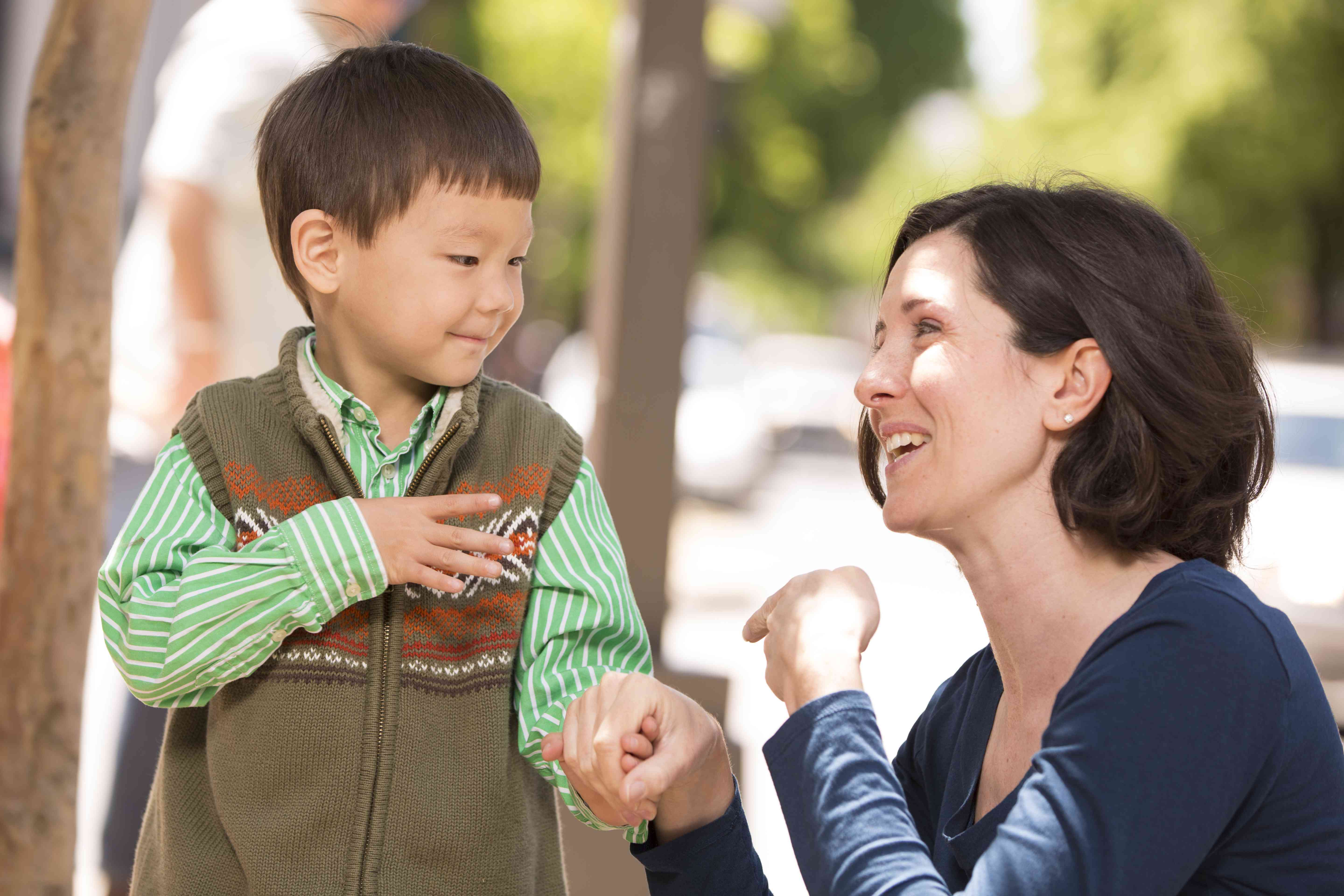 Parent communicating with child in sign language