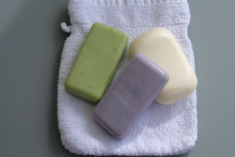 Directly Above Shot Of Soap Bars On Towel
