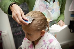 Young child being checked for head lice.