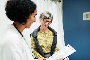 A woman talking to her doctor in an examination room