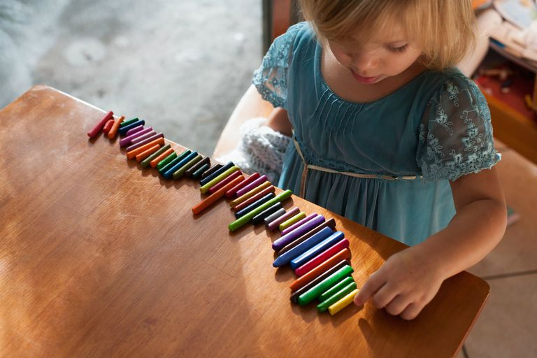 Child lining up blocks