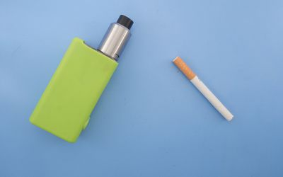High Angle View Of Cigarettes On Blue Background