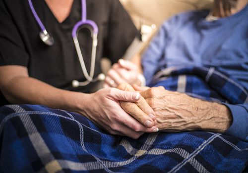 Hospice Nurse visiting an elderly patient