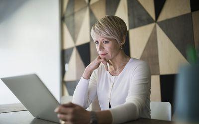 Woman of menopausal age looking at computer