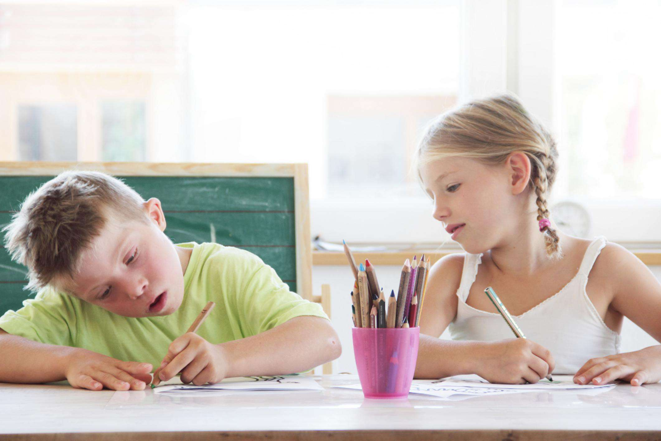 Two children working on their homework together