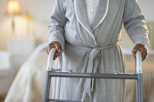 Woman walking with a walker