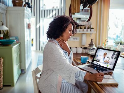 woman consulting with her doctor online