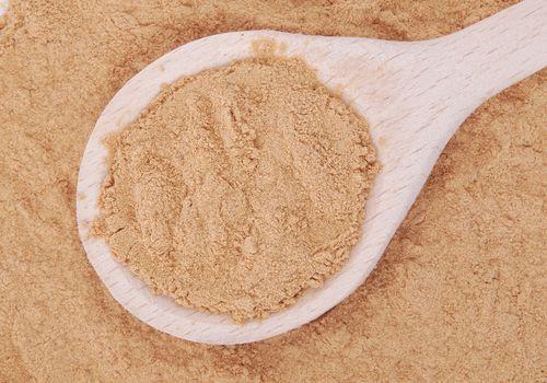 Mesquite flour on a wooden spoon