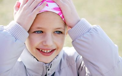 young girl being treated for cancer