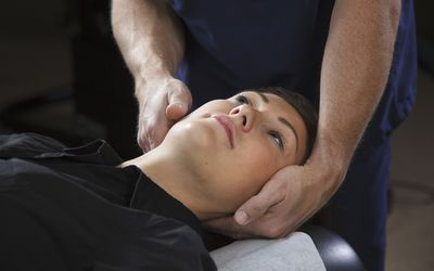 A patient receiving a treatment in a physical therapy office