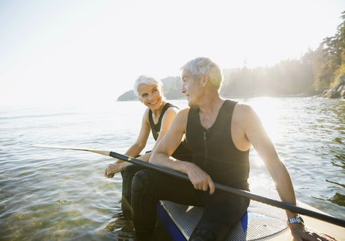 Senior couple on a paddle board in the ocean