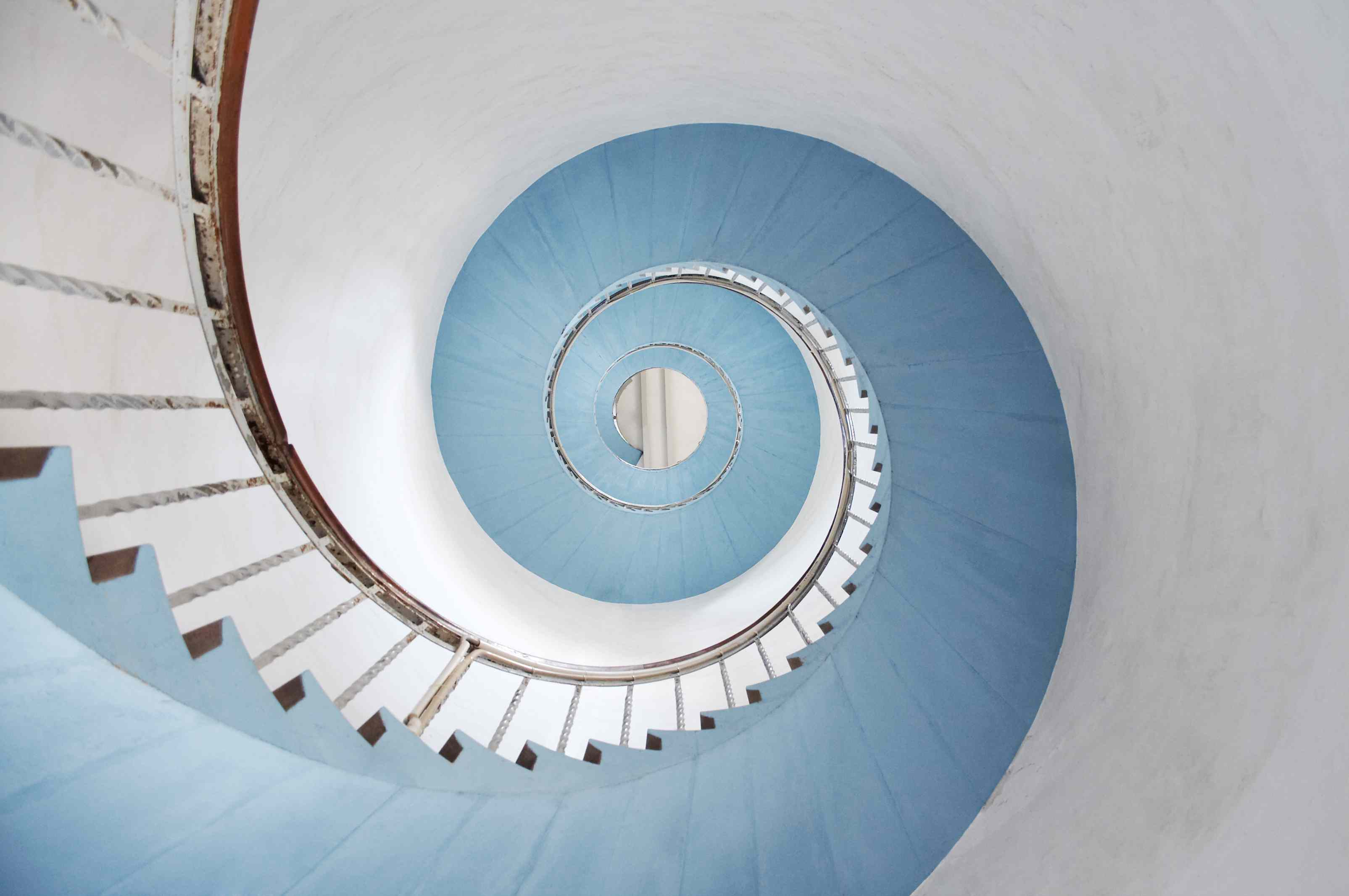 A blue and white spiral staircase