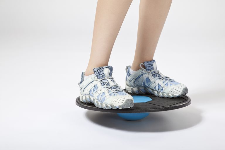 a person balancing on a wobble board