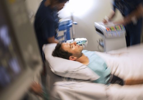 Blurred motion view of patient lying in bed in intensive care unit