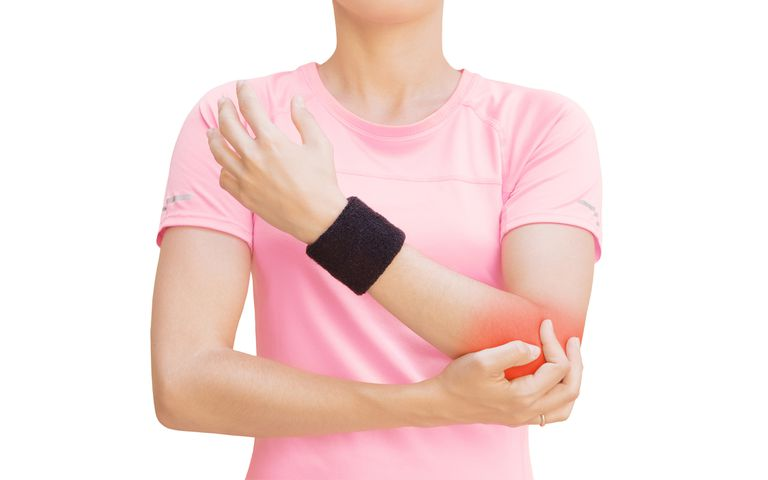 Midsection Of Woman Touching Her Elbow Against White Background