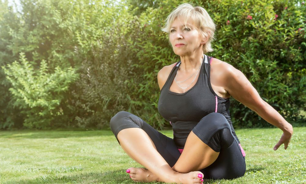 middle aged woman outside exercising to reduce breast cancer recurrence